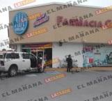 Sujeto aramado asalta farmacia Guadalajara