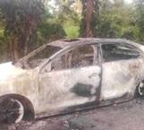 Fuego arrasa con auto y amenaza una vivienda