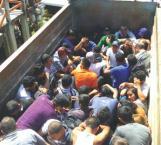 Rescatan 124 migrantes hacinados en camiones