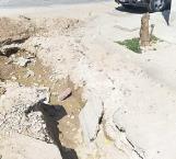 Urgen reparación de calle arreglada