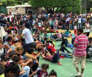 Caravana de migrantes hondureños se enfrentan con PF, luego llegaron a un acuerdo con las autoridades mexicanas