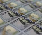 Dólar alcanza los $19.43 en bancos