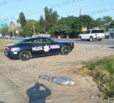 Tiran cuerpo encintado en la carretera a Río Bravo